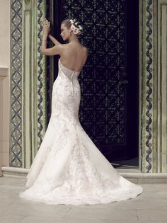 Gown features a strapless sweetheart neckline with a slim A-line silhouette. Exquisite beadwork and embroidery on tulle is over organza and Sleek Satin. The ...