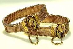 Victorian ladies often wore matching bracelets, both for beauty and symmetry and also to discreetly keep those lovely flowing sleeve cuffs in place!- these are buckle bracelets.