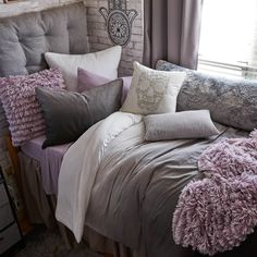 This versatile headboard cushion is the easiest way to upgrade your bed. Simple, great looking, and invitingly cozy, this cushioned headboard takes your room to a whole new level. Purple Dorm Rooms, Light Purple Bedrooms, Mauve Bedroom, Purple Master Bedroom, Black And Grey Bedroom, Purple Bedroom Decor, Room Ideas Bedroom, Romantic Purple Bedroom, Purple And Grey Bedding