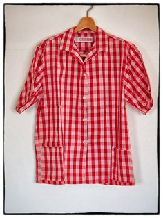 Arakawa's old Palaka Shirt in Red. - Palaka shirts were worn by Japanese migrant field workers in Hawaii had little more than a simple checkerboard design. It is not a print, but is a plaid with a particular texture. The palaka was originally a jacket and somewhere in the 30s it became a shirt.