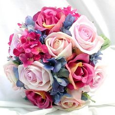 Wedding bouquet in pink and purple with roses.