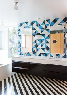 12 Creative Ways to Use Tile in Your Home - Photo 2 of 12 - The vanity countertop is Corian's Glacier White. The sconces are Glo-Ball designs by Jasper Morrison for Flos.