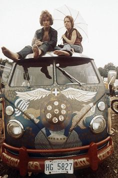 A couple atop the ultimate hippie vehicle — a VW bus — at Woodstock.