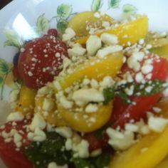 Tomato, feta, fresh herbs (basil, lemon thyme, pineapple sage, and parsley) with evoo, red wine vinegar and sugar. Yummo!
