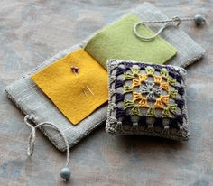"A linen ""needle book"" with granny square cover - very creative"