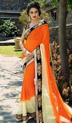 Add a adolescent burst of shade for your wardrobe with this dark orange and cream color shade chiffon saree. The ethnic lace and crystals work at the clothing adds a sign of attractiveness statement with your look. #LatestOrangeAndCreamShadesOfSaree