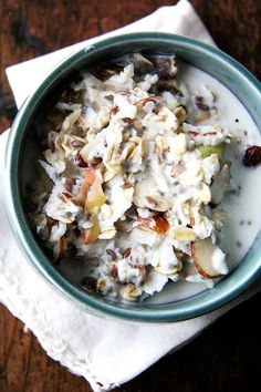 Bircher Muesli — a mix of raw oats, almonds, coconut, chia, flax, dates and golden raisins, soaked in milk and mixed with apple and yogurt