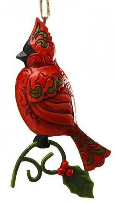 Cardinal Bird Xmas Tree Hanging Ornament collectible by Jim Shore. In beautiful, festive colors of red and green with holly detail.