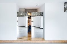 Other details in the apartment include a pair of mirrored doors, designed to create a private dressing area when opened.