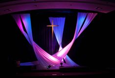 Now that it is fall, it's time for a new stage design! (We change out our designs quarterly.) Our last stage design was very geometric because we used lanterns. This time we went with something that was a big contrast to the previous design: soft fabric swooshes. The fabric was simple white spandex, hung in …