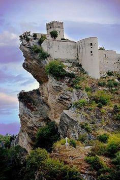 Perched on a hill top, the Roccascalegna Castle in Abruzzo, Italy