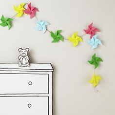 Colorful Pinwheel Garland in bright and bold from Land of Nod (DIY cost: free! think scrapbook paper and jute cord)