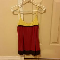 Forever 21 Stappy Tank Cute sleeveless top. Pink and brown and yellow. Very comfortable and cute for going out in the summer time. In very good condition. Forever 21 Tops Tank Tops
