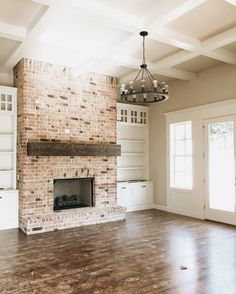 Whitewashed Fireplace with painted built-ins in ivory and neutral wall color