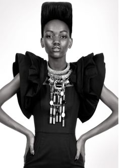 Ottawa native, Harieth Paul knows volume. Black and white photo, fashion photo shoot, sleeves, bold statement necklace.