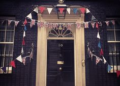 Downing Street is gearing up to celebrate Queen Elizabeth II's Diamond Jubilee.    In preparation for a street party, decorations are being put up around the house and along the street.