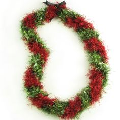 A Hawaiian Christmas. Hawaiian Hakuhia Eyelash Crochet Lei in Christmas red and green. Available at Black Pearl Designs.