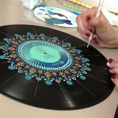 Mammals painted vinyl records for decorative wall art This record is just getting better and better! I am sick as a dog today, so you're lucky I spared you the audio of this time lapse, which… Dot mandala on record Dot painting on an old record album Mandala Art, Mandala Rocks, Mandala Painting, Vinyl Record Crafts, Vinyl Art, Vinyl Decor, Dot Art Painting, Soul Art, Recycled Art