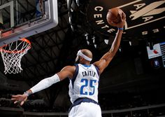 Vince Carter rises for a dunk.