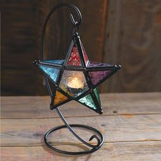 stained glass star candle holder comes with a wrought-iron curlicue stand. We strongly recommend our rechargeable tea lights for safety and ease of use. See order form for details. Stained Glass Light, Stained Glass Projects, Stained Glass Patterns, Stained Glass Windows, Mosaic Patterns, Mosaic Glass, Fused Glass, Star Lanterns, Glass Boxes