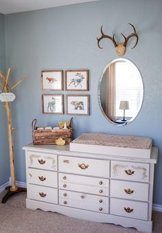 """This nursery designer says """"rustic"""" and """"elegant"""" aren't mutually exclusive terms. From wood-paneled walls to antler accents, we found the right ways to go rustic."""