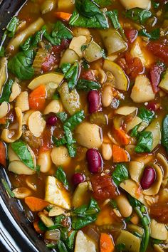 Slow Cooker Minestrone - this is soooo good and so healthy! Perfect use for all the fresh summer veggies, zucchini and all.