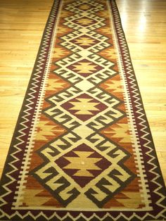 heres another nice dhurrie runner. this would look great in any homes hallway.