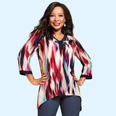 """Long, tunic-length blouse with a hi-low hem, lace-up grommet neckline and vibrant multicolored print for a cool, boho chic look.· 100% Polyester· Length from highest point of shoulder to center front/back: 28"""" (S/M); 40-1/2"""" (1X/2X)· Machine wash, cold, with like colors; do not use chlorine bleach, use only non-chlorine bleach, if needed. Tumble dry, low; warm iron as needed.· Imported"""