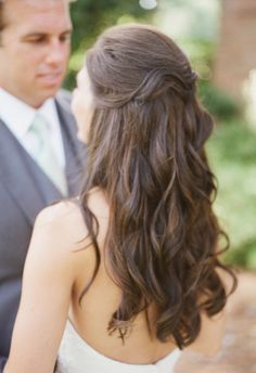 Loosely pinned up, curly, effortless bridal hair // Leslie Hollingsworth Photography