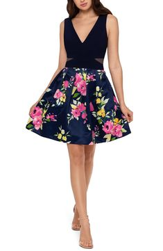 Free shipping and returns on Xscape Floral Print Fit & Flare Cocktail Dress at Nordstrom.com. Colorful blooms atop a dark backdrop give a romantic twirl to this party dress topped by a shapely V-neck bodice with mesh waist cutouts.