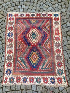 JUST AS FOUND! Beautiful and early Bordjalou rug, unfortunately with many bad repairs but due to its colors and rare white-grounded star border it still has lots of magic and character I  ...