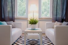 Interior Inspiration colors from the sea. Coffee Table, Black and white Carpet, grey Curtains