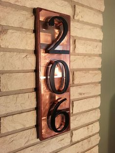 House numbers address plaque- copper on mahogany wood with raised numbers. LOVE LOVE LOVE.