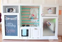 Turn an old entertainment center into a faux cooking space for your kids. This one's much more special than anything you'd find at a store — and you can even treat them to a stainless steel fridge!