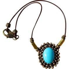 Antiqued Brass Pendant with German Glass Necklace ❤ liked on Polyvore featuring jewelry, pendants, blue glass jewelry, antique brass pendant, blue jewelry, western jewelry and vintage jewelry