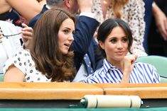 Kate Middleton Photos - Catherine, Duchess of Cambridge and Meghan, Duchess of Sussex attend day twelve of the Wimbledon Lawn Tennis Championships at All England Lawn Tennis and Croquet Club on July 14, 2018 in London, England. - Day Twelve: The Championships - Wimbledon 2018