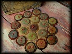 Love the more subtle colors in this little penny rug -- and it is tied like the old fashioned quilts.