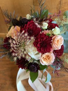 Loved it! Pinned it! A Blooming Envy Design! Wedding Bouquet designed with Burgundy Dahlias, Peach Roses, White Roses, Burgundy Scabiosia, Chocolate Queen Anne's Lace and eucalyptus.