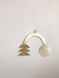 """NOTE: Made-to-order designs currently have a 2-week turnaround time to ship. Mobile/ wall hanging combo made of brass sheet. This piece can either be strung from the ceiling as a kinetic sculpture or flat against a wall. Measurements: roughly 11"""" x 9"""" Note: Brass naturally"""