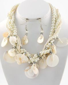 "CHUNKY CREAM FAUX PEARL SILVER TONE NECKLACE SET WITH SHELL ACCENTS    * If you need a necklace extender I have them for sale in my store.*        NECKLACE: 16"" LONG + EXT    DROP: 2 1/4"" L               HOOK EARRINGS: 2 1/8"" LONG                     COLOR: SILVER TONE  $21.99"