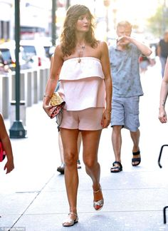 The pin parade: Helena Christensen, 46, displayed her bronzed legs in a pink thigh-skimmin...