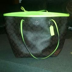 Coach purse and wallet ***ONLY FOR TRADE AT THIS TIME***This is in excellent condion only carried a few times. No flaws. Dark brown leather with C's neon yellow trim. Large taxi tote. Coach Bags Totes