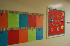 From Mrs. Lee's Kindergarten (this is her sister's classroom). A really great way to display artwork all year long. Each clothespin also has glitter on it!
