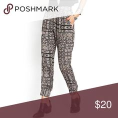 Forever 21 tribal-inspired woven joggers These woven joggers have front pockets and a tribal print in black and beige. They have a hidden side zipper for taking them off and on. The ankles are elasticize for a slimmer fit at the ankles. Wear these with a tank top and booties for a boho look. Worn exactly once. In great condition. Cover photo courtesy of Forever 21. Forever 21 Pants Track Pants & Joggers