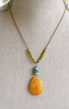 This is a beautiful 17 antique brass and czech glass beaded necklace. The pendant is a vintage green bead,rhinestone rondelle and czech glass bead