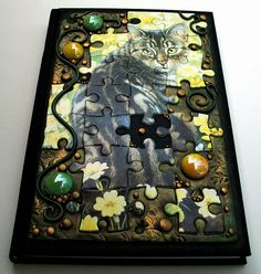 Puzzle Cat blank journal by MandarinMoon, via Flickr