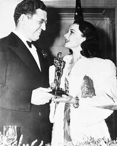 """British actress Vivien Leigh, holding her Oscar, which she won for Best Actress for her role in the film """"Gone With The Wind"""", talks to American film producer David O. Selznick, at the banquet of the Academy of Motion Pictures, Arts and Sciences, in Hollywood, Calif., on Feb. 29, 1940. Selznick also won a special award for the same film. (AP Photo)"""