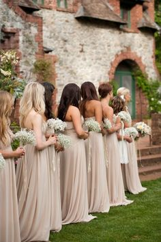 Soft taupe/champagne colored bridesmaid gowns w/ all white gypsophila  (baby's breath)  bouquets...pretty brown shawls/shrug would be pretty to cover shoulders  for a winter wedding
