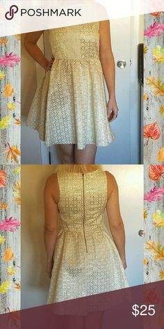 Fit & Flare Dress This adorable sleeveless dress has youthful charm & a grown up attitude! Ivory with gold geometric flower like pattern. Bodice has trim of white lace overlay . Zipper back closure. No pockets. Sits above knees. Xhilaration Dresses Mini