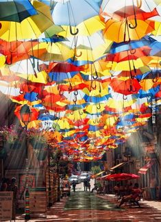 Umbrellas Street, From July to September hundreds of colorful umbrellas float above the shopping promenades of Agueda, Portugal as part of the local Agueda Art Festival. Beautiful Streets, Beautiful World, Beautiful Places, Oh The Places You'll Go, Places To Travel, Places To Visit, Umbrella Street, Colorful Umbrellas, Shade Umbrellas